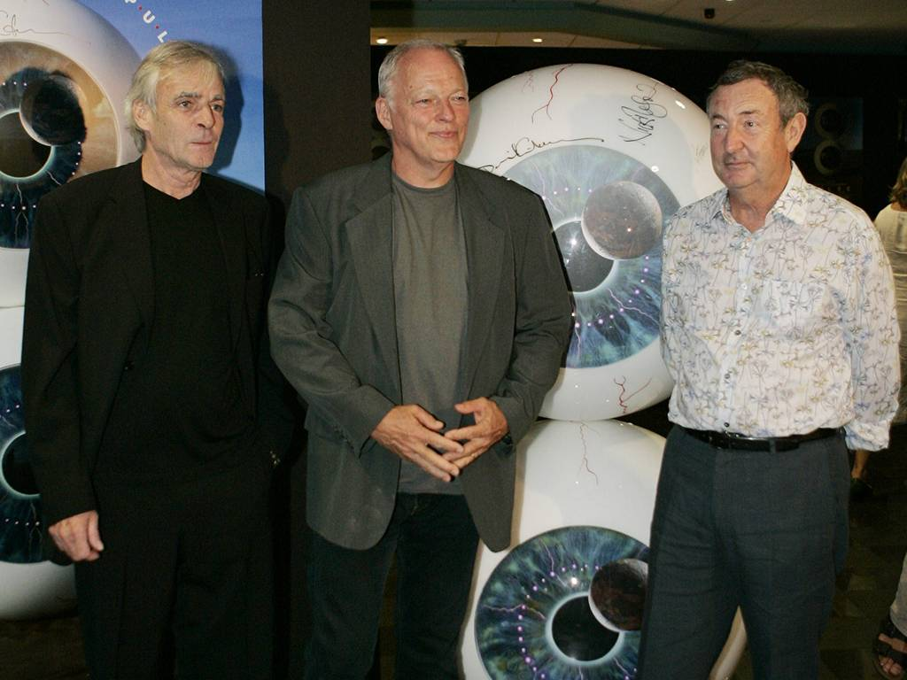 Members of Pink Floyd: David Gilmour, center, Nick Mason, right, and the late Rick Wright, left, arrive for the screening of the group's new DVD at a cinema in central London's Leicester Square, on Monday, July 3, 2006.